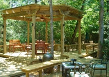arbor-pergola-with-decking-surrounding-and-several-sitting-areas
