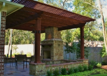 arbor-pergola-with-fire-place-and-small-flower-beds