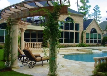 arbor-with-roman-columns-swimming-pool-and-landscape