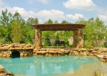 arbor-with-stone-columns-and-swimming-pool-with-cave
