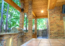brick-outdoor-kitchen-with-stainless-steel-appliances-and-patio-cover