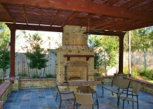 fire-place-pergola-large-bench-and-small-flower-beds