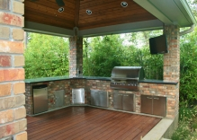 large-outdoor-kitchen-patio-cover-with-granite-counter-tops-stainless-steel-appliances-landscape-ipe-wood-decking-on-floor