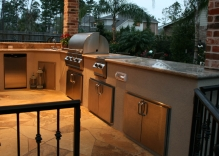 large-outdoor-kitchen-with-granite-counters-stainless-steel-appliances-flagstone-flooring