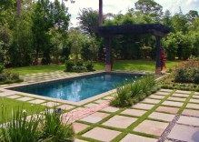 Modern-Swimming-pool-with-arbor-landscaping-flower-beds-stepping-stones