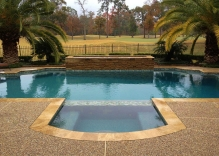 Modern-swimming-pool-remodel-with-small-water-feature-and-hot-tub