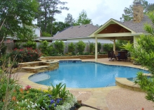 Traditional-Swimming-pool-with-small-water-feature-surrounded-by-landscape-and-patio-cover-cabana