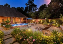 geometric pool with deck jets, tanning ledge and pool landscaping