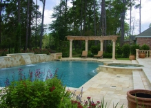 mediterranean-pool-with-spa-that-spills-over-into-swimming-pool-water-feature-along-backside-of-swimming-poo-with-a-circular-arbor