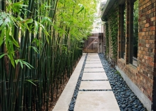 Walkway-with-mexican-beach-pebbles-and-bamboo